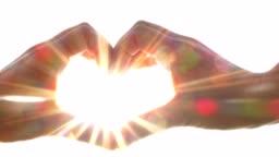 heart shape made of hands, sun beams, brightness, love