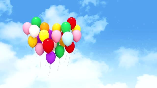 ハート型の熱気球の空 - 沢山の物点の映像素材/bロール