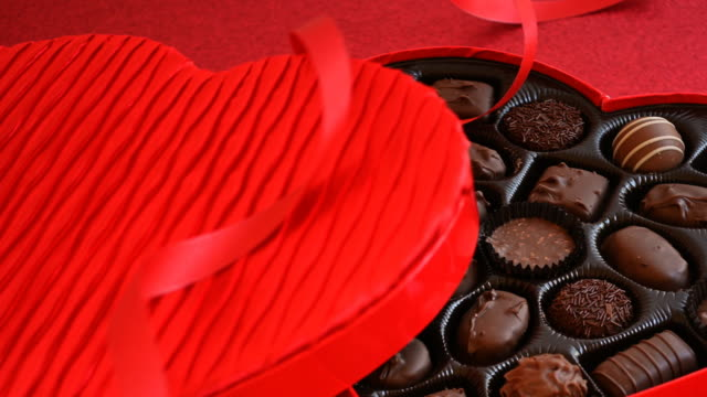 heart shaped chocolate box on table - valentine's day stock videos & royalty-free footage