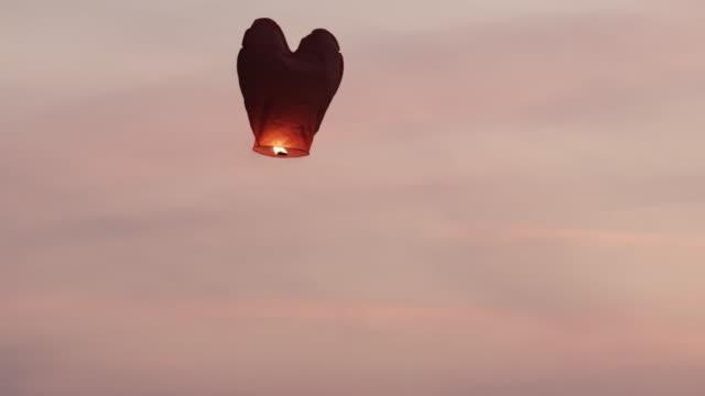 Heart - shaped lantern floating up the sky