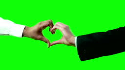 Heart Shaped Love Symbol by 2 Business Men in Suit and Shirt on Green Screen 4k Video Footage Set.