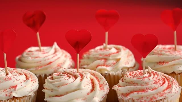 heart shapes on tempting cupcakes - icing stock videos and b-roll footage