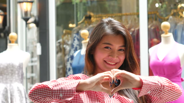 Heart Sign by confident fashion designer
