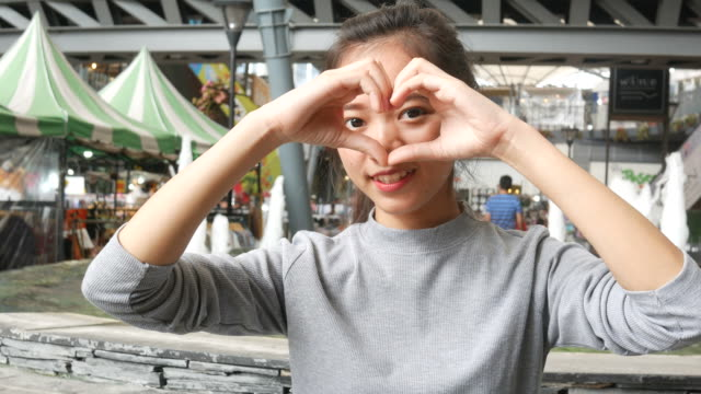 heart sign by young asian woman - affectionate stock videos & royalty-free footage