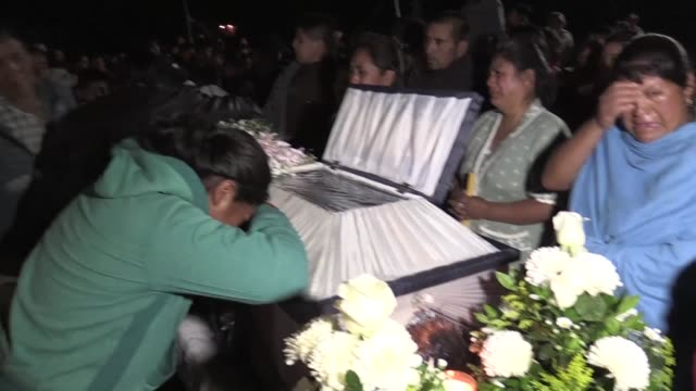heartbreaking cries rip through rural mexican village as families mourn the 11 children killed in a fireworks explosion at a warehouse as villagers... - grief stock videos & royalty-free footage