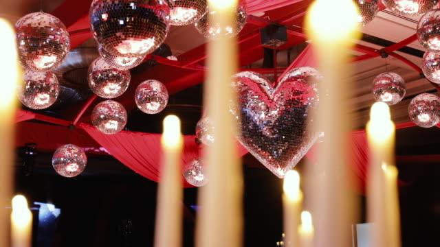hearth shaped disco ball on wedding decoration in luxury hotel - formalwear stock videos & royalty-free footage