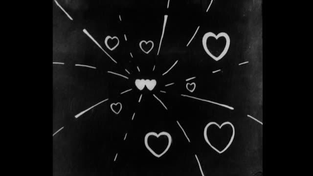 hearts explode like continuous fireworks against a dark sky - love stock videos & royalty-free footage
