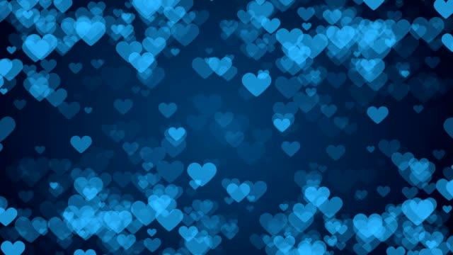 青の背景に心のフレーム。抽象的なバレンタインデー カード。 - バレンタインデー点の映像素材/bロール
