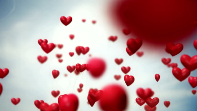 heart-shaped ballons flying (red) - loop - love emotion stock videos and b-roll footage