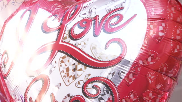 "a heart-shaped helium balloon reads, ""i love you"". - i love you stock videos and b-roll footage"