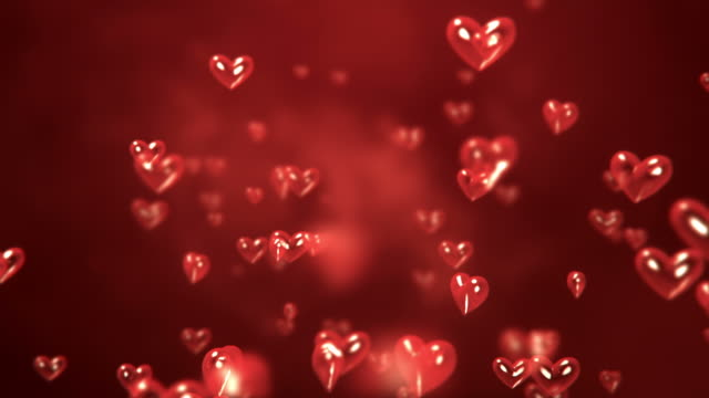 heart-shaped particles flying - loop - valentines background stock videos & royalty-free footage