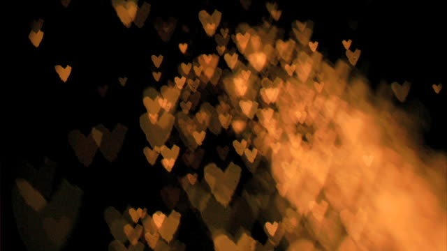 heartshaped sparks flying in super slow motion - conceptual symbol stock videos and b-roll footage