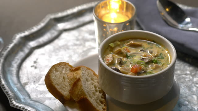 hearty chicken soup paired with crusty bread and white wine. - anorexia nervosa stock videos & royalty-free footage