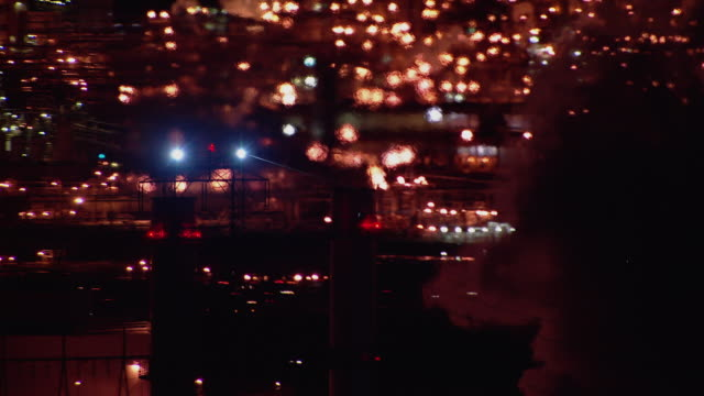 Heat haze over New Jersey power plant at night.