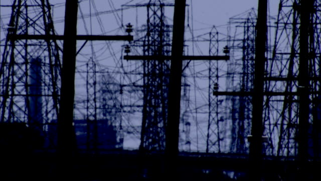a heat haze shimmers in front of electrical pylons and power lines. available in hd. - telegraph pole stock videos and b-roll footage
