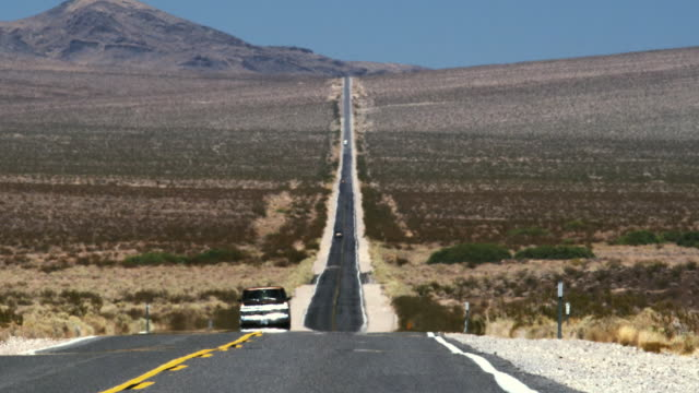 WS Heat waves on straight desert road with light traffic / Pahrump, Nevada, USA