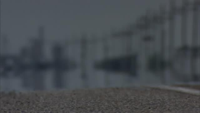 heat waves shimmer on hot asphalt. - illusion stock videos & royalty-free footage