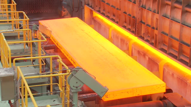 heated iron ingot coming out of the machine - metallindustrie stock-videos und b-roll-filmmaterial