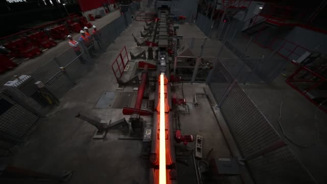 a heated steel billet makes its way through a rolling mill at the voestalpine wire rod austria gmbh plant in sankt peter freienstein austria on... - traditionally austrian stock videos and b-roll footage