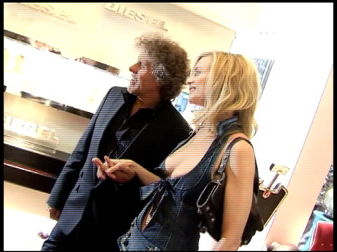 heather graham and renzo rosso at the diesel london store launch party inside at new bond street store in london on may 18 2006 - rosso stock videos & royalty-free footage