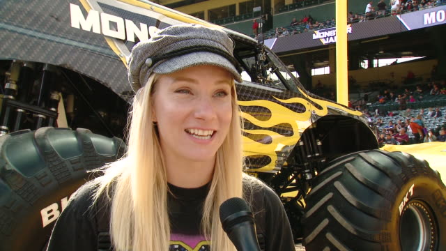 heather morris on tell us who are you here with today and what are you looking forward to seeing at monster jam, on which truck is your favorite and... - angel stadium stock videos & royalty-free footage