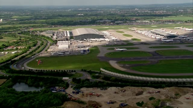 london heathrow airport heathrow airport with british airways aircraft parked at gates and stationary on taxiways / terminal 5 / planes lined up - taxiway stock videos & royalty-free footage