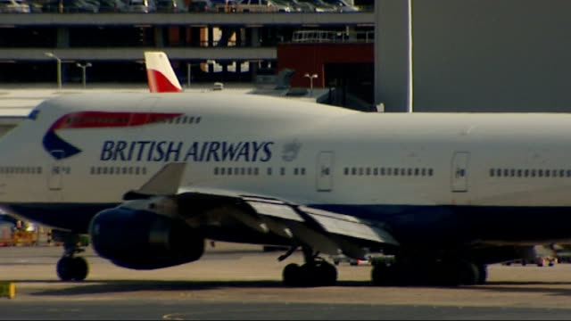 Aircraft taking off and landing ENGLAND London Heathrow Airport EXT British Airways aircraft taxiing / British Airways Boeing 747400 aircraft taxiing...