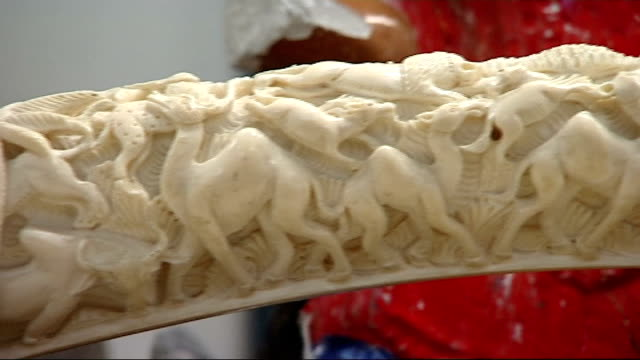 heathrow airport becomes hub for illegal ivory smuggling england london int ivory rings carved ivory sculptures ivory carving ivory ornament of woman... - lavoro d'intaglio video stock e b–roll