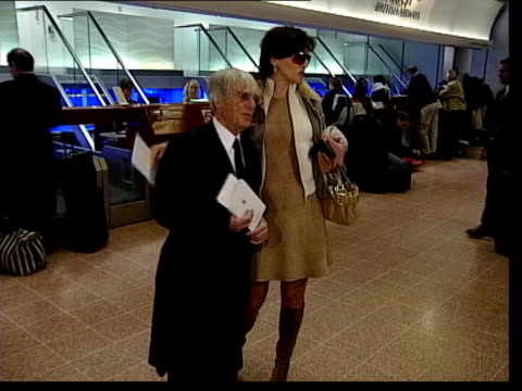 heathrow airport: bernie ecclestone and wife slavica posing for photocall at check-in area - bernie ecclestone stock videos & royalty-free footage