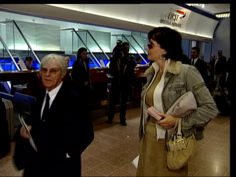 bernie ecclestone and his wife slavica ecclestone at ba checkin area at airport clean feed tape = d0509973 or d0509974 00165500 00201200 fx/mix... - bernie ecclestone stock videos & royalty-free footage