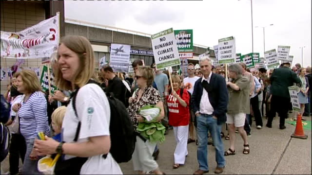 planning law reforms england london ext protesters against the expansion of heathrow airport along on protest march man dressed in green costume... - stilts stock videos and b-roll footage