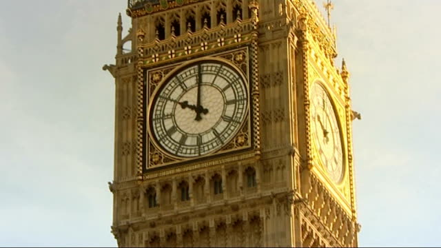 heathrow airport protests: planning law reforms; tx 27.2.2008 westminster: houses of parliament: big ben clockface, environmentalists on roof of... - roof stock videos & royalty-free footage