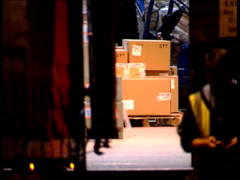 london heathrow airport delivery lorry backed up to warehouse which was the target of armed robbers bv security officer looking into warehouse then... - thief stock videos & royalty-free footage