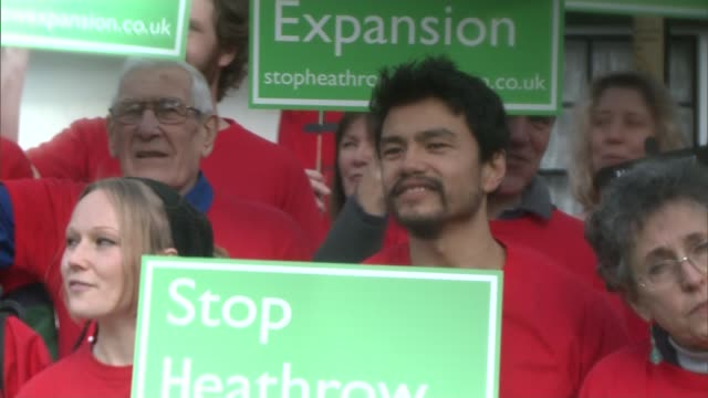 heathrow families give support to protesters facing jail england london near heathrow int protesters applauding at meeting group of protesters... - itv london tonight weekend点の映像素材/bロール