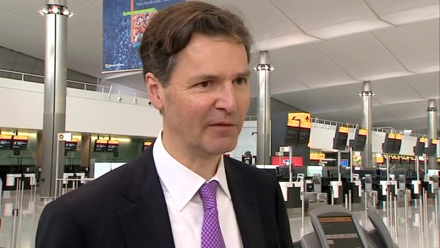 heathrow terminal 2 opens to passengers terminal 2 john hollandkaye interview sot cutaway staff member attaching luggage tag to suitcase various... - tag 2 stock-videos und b-roll-filmmaterial