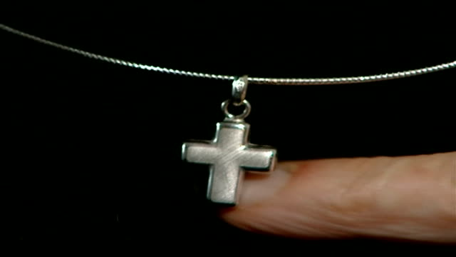 heathrow worker sacked for wearing nose piercing england london cross on chain worn outside clothing of nadia eweida who refused to wear crucifix... - nose piercing stock videos & royalty-free footage