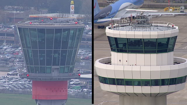 vídeos de stock, filmes e b-roll de heathrow's annual profits have fallen 10 percent it posted its full year results today and say the airport is full to capacity showing exterior shots... - torre de controle de tráfego aéreo