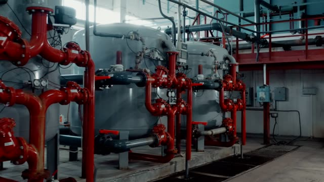 heating equipment in a boiler room of the large enterprise. - boiler stock videos & royalty-free footage