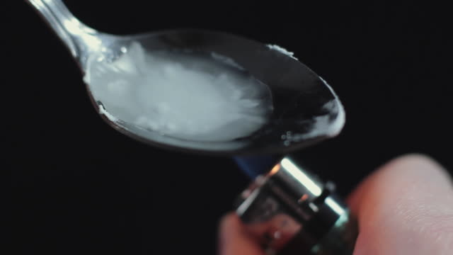 SLO MO CU Heating heroin for injection