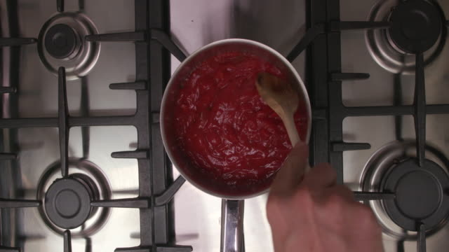 heating up bolognese sauce in saucepan - cooker stock videos and b-roll footage
