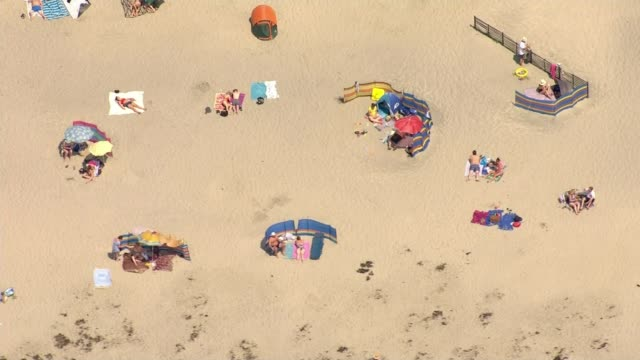 Heatwave across parts of Britain Lancashire Blackpool People on beach and lifeguard in water AIR VIEW Blackpool beach