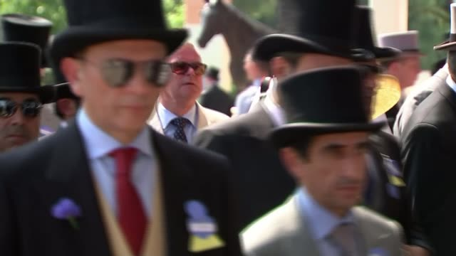 Heatwave across parts of Britain Men along in top hats and morning suits Spectators in seats in Royal enclosure