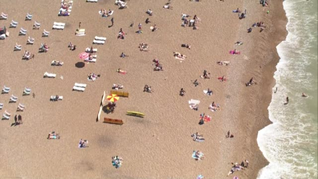 Aerials of Brighton beach ENGLAND East Sussex Brighton EXT **Picture quality as incoming** of Brighton beach on sunny day shows people sitting on...