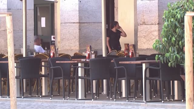 stockvideo's en b-roll-footage met heatwave breaking records with temperature passing 45 degrees celsius spain catalonia girona ext various shots of empty tables outside cafes and... - recordbrekend