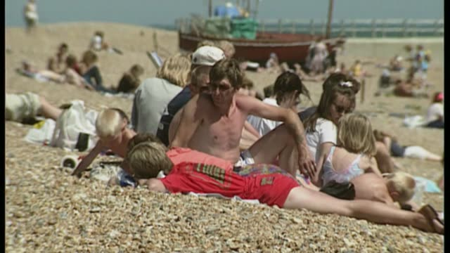 Hottest June day for 41 years BSP300695027 TX People sunbathing on beach and wading in sea water