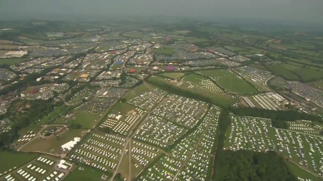 Hottest June day for 41 years Somerset Galstonbury Glastonbury Festival tents cars in fields