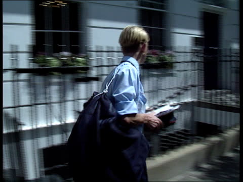 ozone/uv radiation fears **** for england london ms man and woman post office workers towards in summer shorts lams postman out of office in shorts... - uv protection stock videos and b-roll footage