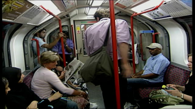 record temperatures in britain; int tube train back view of passenger along underground carriage close shot of thermometer reading 51.1c passenger... - heat stock videos & royalty-free footage