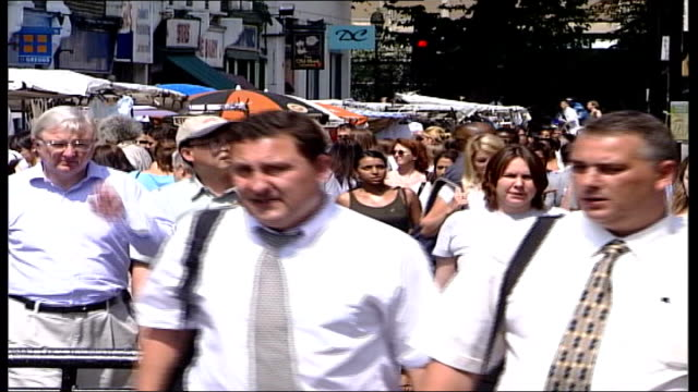 call for law change to protect workers; london: ext general views people along up busy pedestrianised street builder standing with hands on hips... - hüfte stock-videos und b-roll-filmmaterial
