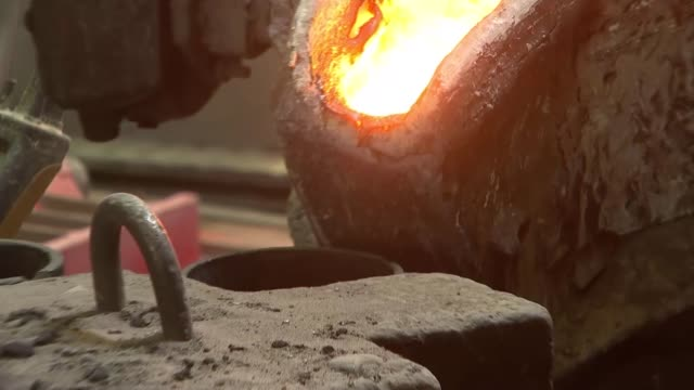 uk experiences second hottest day on record england oxfordshire banbury swan group foundry int molten metal poured in to container in iron foundry... - foundry stock videos & royalty-free footage